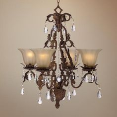 This dignified four-light iron chandelier combines rustic and elegant styles with an earthy oak leaf design and crystal accents. Style # at Lamps Plus. Chandelier Lighting Fixtures, Rustic Chandelier, Mini Chandelier, Dining Room Lighting, Sloped Ceiling, Ceiling Lights, Closet Remodel, Iron Chandeliers, Bronze