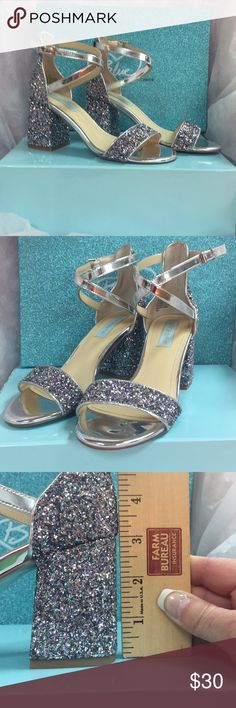 "Betsy Johnson Silver/Multi glitter heels Betsy Johnson "" Lane"" Silver & Milti glitter 3"" heels with crisscross ankle strap. Perfect for prom or padgent. Only worn for about 20 minutes, excellent condition. Betsey Johnson Shoes Heels #anklestrapsheelsprom"