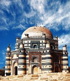 Uch Sharif near Bahawalpur, Pakistan. The Tomb of Bibi Jawindi is one of the five monuments in Uch Sharif, Punjab, Pakistan. The shrine was built in 1493 by Iranian prince, Dilshad, for Bibi Jawindi who was the great granddaughter of Jahaniyan Jahangasht, a famous Sufi saint. The site is located in the south-west corner of Uch, a historical city founded by Alexander the Great. (V)
