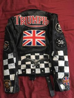 This is a Wilson's Leather motorcycle jacket, men's size medium, customized in the style of the British Rocker motorcycle clubs of the 1960s. Jacket is repurposed, cleaned and conditioned, and then customized. Patches and paint are aged by hand to make this look like a well-worn relic.