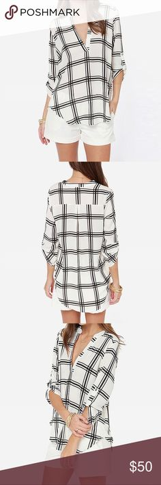 Rolled Sleeve Slinky Windowpane Blouse Perfect for an autumn transition piece, you can wear this blouse alone or layered. The black and white check pattern easily goes from day to night. True to size, for a loose, oversized look, order a size up.  ❌ Sorry, no trades. fairlygirly Tops Blouses