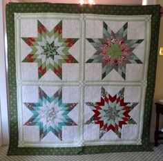 Sparkle, using Jelly Stars pattern from Fig Tree Quilts and a jelly roll of Blitzen.