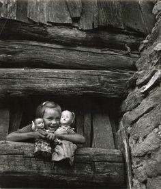W. Eugene Smith. Child hugging dolls, Blue Ridge Mountains, 1947