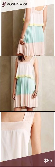 Maeve Anthropologie Pleated Tiered Dress Beautiful, flouncy, light, feminine & fun dress in EUC.  It has color blocks of blush/rose, mint green, ivory and bright yellow band with pleat details.  Brand is Maeve (for Anthropologie) though the inside tag has a line because I bought at a sample type sale.  Material is 100% polyester, fully lined.  Back has two decorative buttons-top one could be tightened as pictured, but is fully attached.  Side zip for getting in and out :). I wore once last…