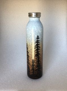 A personal favorite from my Etsy shop https://www.etsy.com/listing/486214370/pine-tree-dawn-water-bottle
