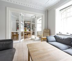 Vahle folding glass door in nicely decorated apartment - door folds flat onto…