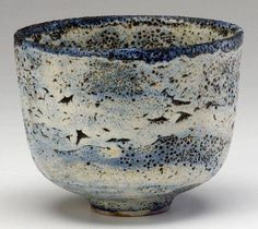 I see birds flying in a beautiful mountainous landscape, this cup is so lovely
