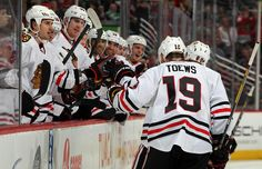 Fist bumps all around after the captain scores his 14th goal of the season.