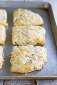 Perfect for breakfast on the run, this Sausage and Cheese Biscuit Recipe has all the goodness of breakfast combined into one jumbo tender biscuit. **I substituted mild Italian sausage because my families tastes. Fondue Recipes, Cheese Recipes, Brunch Recipes, Cooking Recipes, Sausage Recipes, Party Recipes, Scone Recipes, Bisquick Recipes, Apple Pie Recipes