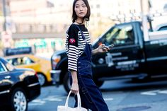 Try a striped tee under overalls for a tomboyish look // Photo: The Styleograph #NYFW #streetstyle