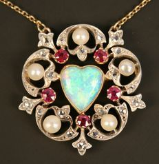 An opal, ruby, rose diamond and cultured pearl pendant, mounted with the heart shaped opal in a surround of five cushion shaped rubies, alternating with five cultured pearls, otherwise set with rose diamonds, with a neckchain.