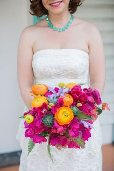 """I wanted to highlight the state's natural beauty with local plants and flowers,"" Mindy says. ""Bougainvillea grows everywhere in southern Florida, so we made it the staple floral."" Designed by Lara's Theme, her bouquet consisted of the ornamental plant's brilliantly colored bracts accented with orange ranunculi, bright yellow billy balls, succulents, and fern fronds."