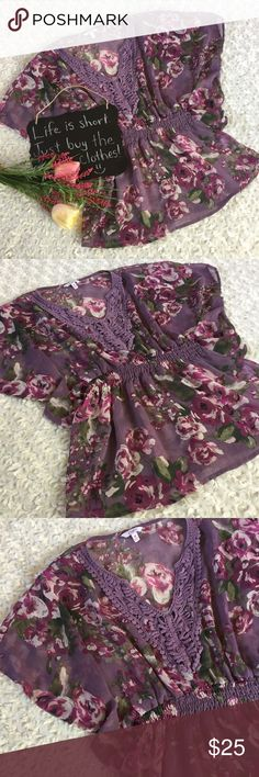"""Candie's purple floral top Sheer purple floral top by Candie's. Adorable!! Bat wing sleeves with elastic at waist. Size M. 18.5"""" arm pit to arm pit. 25"""" length. Candie's Tops Blouses"""