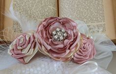 This listing is for a beautiful fabric flower hair fascinator and a vintage style birdcage veil. You can purchase flower headpiece together
