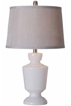 Aniston Table Lamp - Crisp Clean Lines Are The Hallmarks Of This Elegant Table Lamp - The Aniston Table Lamp Is A Classic Style Choice For Your Living Room, Bedroom Or Study. Expertly Crafted Of Glass With A Lovely Milk White Finish, This Exquisite Lamp Boasts A Silver Drum Shade With Metallic Shimmer. Versatile, Traditional Styling. Shimmery Silver Polyester/Cotton Blend Shade.