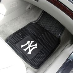 Support your favorite NBA team while on the road with the Dallas Mavericks Floor Mat Set. The officially licensed, heavy duty vinyl vehicle floor mats feature a molded, raised team logo in bright team colors. Decorative ribbing ensures a good hold. Vinyl Floor Mat, Floor Mats, Yankees Gear, Mickey Mouse, Back Row, Front Row, Perfect Gift For Dad, Minnesota Timberwolves, Miami Marlins
