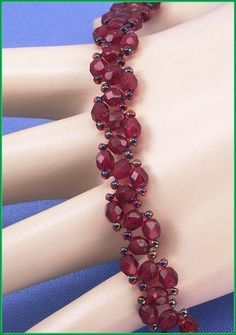 """Jewelry is made with small beads. Some are glass or stone. Adult supervision is recommended. This bracelet is made with Miyuki 11/0 garnet lined ruby glass seed beads along with 4mm garnet fire polished beads and hooks with a lobster claw clasp. Measures approx. 73/4"""" long (including clasp) by 3/8"""" wide and is a design pattern from: inspired by Deborah Roberti. Priced at only $25.50 with """"FREE SHIPPING"""""""