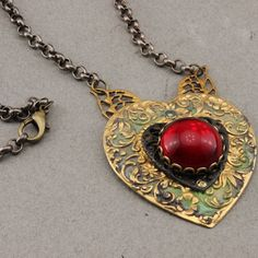 Heart Necklace in Brass and Czech Glass by oscarcrow on Etsy, $25.00   A romantic little number from Harry Wood, metalworker.