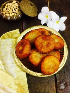 Delicious and finger licking good Suji Manda Pithas, deep fried semolina dumplings stuffed with coconut and jaggery...authentic and traditional Pitha made in festivals and special occasions in Odisha.