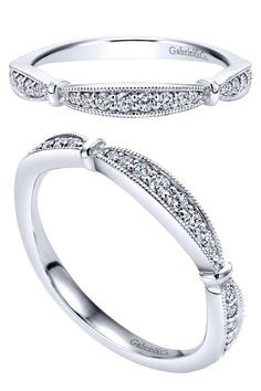 A 14k White Gold Victorian Curved Wedding Band by Gabriel & Co. We love all the little diamonds in this beautiful and unique piece. Match your engagement ring and wedding band to make a perfect bridal set with Gabriel & Co.