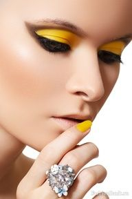 yellow eyeshadow with black winged liner