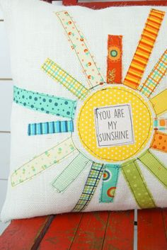 This adorable You are my Sunshine pillow is handmade using a variety of bright colored fabric strips to create a bright & vibrant sunshine which is sewn onto a burlap background with a tag in the cent