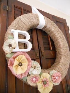 Summer Wreath. This would be nice on our door next year since my last name will be BEnko.