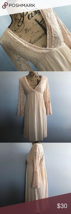 "Boho Chic Ivory Lace Bell Sleeve Dress Boho Chic Ivory Lace Bell Sleeve Dress, Size Large, NWT, lined, Smoke Free Home  Measurements are approx.   Length: 34"" Chest: 40""  Sleeve: 20"" Jodifl Dresses Midi"