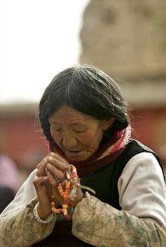 woman at prayer, lhasa, tibet