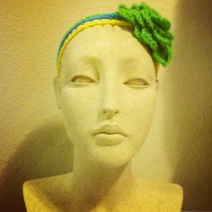 Headband I was working on earlier :) Spring green, bright yellow and blue flower three strand headband made if 100% acrylic yarn from the USA. $15.00