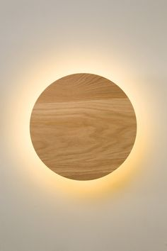 (Kendall could make these) Radiant wall sconce by Rich Brilliant Willing / The effect is reminiscent of a solar eclipse