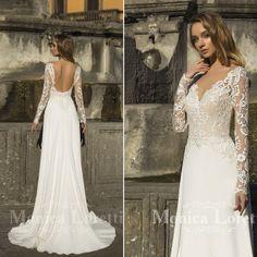 3a8f7987503a Bellissimo abito da sposa in pizzo bianco dallo stile moderno articolo  Maricel Monica Loretti