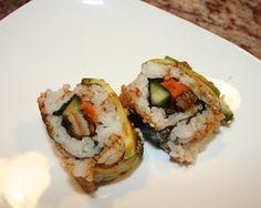 Vegan Caterpillar Roll - Inside - teriyaki flavored shitake mushroom, yam, cucumber. Outside - avocado, sesame, teriyaki sauce.