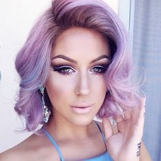 Purple. Love her short pastel loose curls. Her whole look is perfect.
