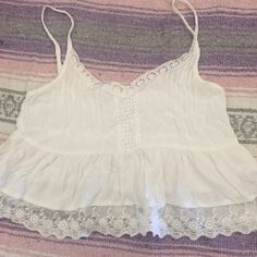 LF Millau White Lace Tank Perfect, gently used condition, only worn a few times! it looks great with a cardigan or flannel  LF Tops Tank Tops