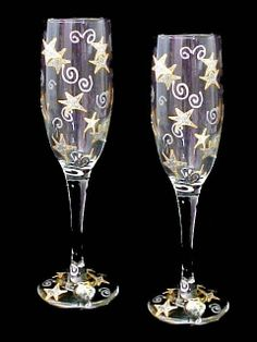 Wishing on the Stars Flutes - This shimmering set of (2) champagne flutes will make all your wishes come true. When was the last time you looked up into the sky and wished on a star?