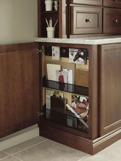 Another clever side cabinet idea. Shallow cabinet that opens from the side to hide keys, message board and misc. Base Message Center by Thomasville Kitchen Base Cabinets, Kitchen Desks, Kitchen Redo, Kitchen Storage Solutions, Kitchen Organization, Organizing, Thomasville Cabinetry, Shallow Cabinets, Cabinet Door Styles