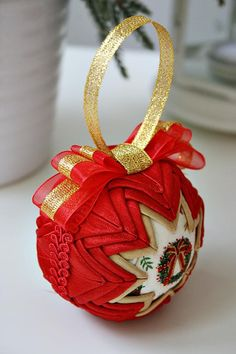 This quilted ornament is made from red and gold fabric (optional: with the red/gold ribbon on the top). This ornament measures approximately 3 in diameter. It will look perfect on your Christmas tree ;) All my products are 100% HANDMADE. And they are made with LOVE and PASSION.
