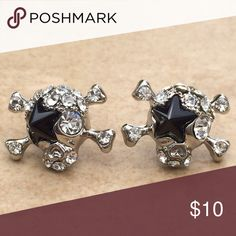 Silver Tone Black Star Crystal Skull Stud Earrings Silver tone stud earrings feature a super star skull with a black crystal star eye patch and is set with glittering clear crystals.  Posts with friction backs complete the look.  Earrings measure 1/2 inch L x 5/8 inch W. Jewelry Earrings