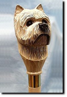 Cairn Terrier Dog Walking Stick. The Cairn Terrier Dog Walking Stick is a reproduction of an original woodcarving by Michael Park, a Master woodcarver, recognized worldwide for his detailed carvings and reproductions. Each walking stick is cast in resin and hand painted by master artists capturing a style of charm and warmth.
