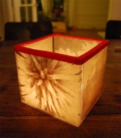 awesome DIY...Add art inserts into your 4 main trays that you think will look good against the glow of a candle. Glue the case trays (5 total) into a cube shape and decorate the open lip with a ribbon.  A battery operated candle or tea light is suggested for safety measures.
