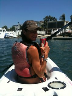 Enjoying a nice cold beer while kayaking after the Long Beach, 10K!