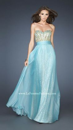 A lovely pale blue A-line sequined gown with chiffon overlay and dazzling striped sequin bodice, by La Femme.