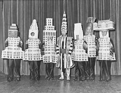 A sublime portrait of the architects wearing the buildings they designed as costumes for the famous Beaux-Arts Ball of 1931