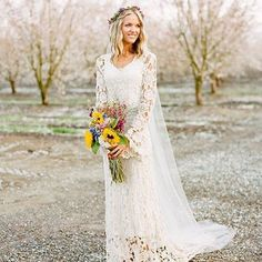 Sunflower wedding bouquet, lacey wedding dress, will it be your wedding choice? | This is amazing! Head over to Altergown where you can see more of their unique works http://www.bridestory.com/altergown/instagram