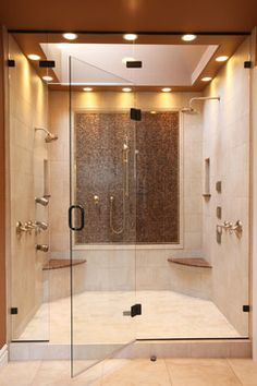 This masterpiece two person shower with separate benches and controls could easily be designed without the step up. Leslie Jensen CMKBD