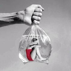 Surreal art woman in plastic baggie with a man holding it close