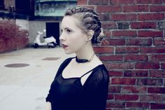 90s twisty cornrow hairstyle and snake ear cuff