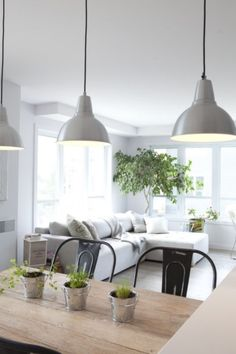 modern gray metal farmhouse pendant lights | wood dining table | black metal dining room chairs