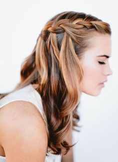 A waterfall braid with curls